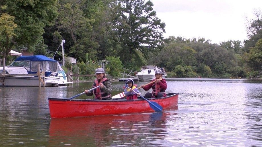 Family paddling at Humber by Canoe Event – Kings Mill Park, Toronto.