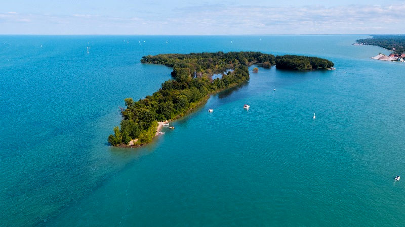 Peche Island, a small spit of land, peaks out of the blue waters of the Detroit River.