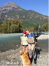 TPC Chair Volker Michelfelder, his wife and dog at the shore of the Bella Coola River