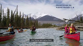 Paddlers on the Fraser River in British Columbia sing O Canada.