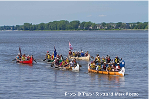 The Canadian Canoe Pilgrimage arriving in Montreal, Quebec.