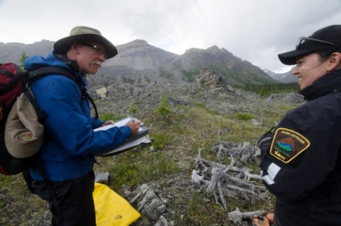 Park Planner, Brian Johnston, and Park Ranger, Alice McCulley, conducting an impact survey along the Bonnet Plume River
