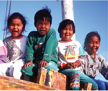 Aboriginal Heritage children smiling together at Soper River, Nunavut